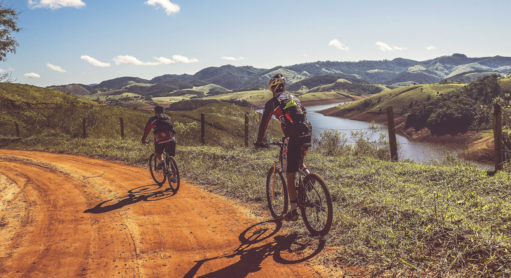 Two mountain bikers riding down a hill, discussing their mortgage options.