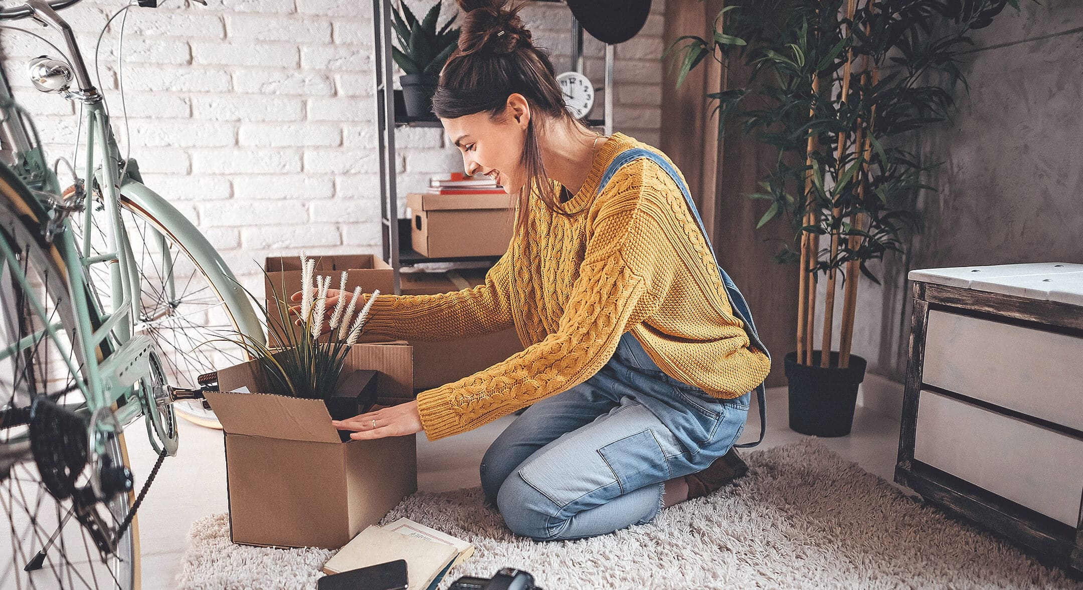A Woman packing up her belongings before moving into her new home.